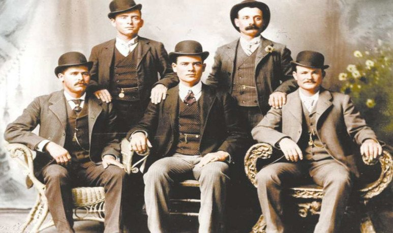 the wild gang Sundance Kid sitting, first left and Butch sitting, first right